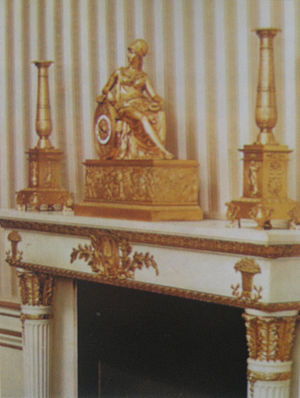 Pierre-Philippe Thomire - Baluster candle sticks and a French Empire mantel clock with a figure of Minerva, (1817). Located in the Blue Room of the White House, shown as decorated by Stéphane Boudin in 1963. The clock is now on a table of the Entrance Hall.