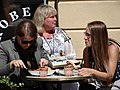 Trio of Women at Cafe - Along the Esplanadi - Helsinki - Finland (35196351963).jpg