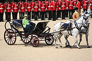 The Queen inspects her Guards in Queen Victoria's ivory-mounted phaeton of 1842.