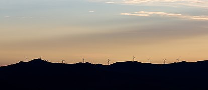 Twilight in Tuscany, wind turbines on a hill range 2-9944.jpg