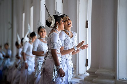 Female dancers in traditional Kandyan dress Two Women in Traditional Kandyan Dress Laugh While Waiting as Secretary Kerry Meets With Sri Lankan Foreign Minister Samaraweera (16720359423).jpg