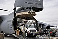 U.S. Air Force airmen unload power repair equipment belonging to Southern California Edison from a C-5 Galaxy aircraft at Stewart Air National Guard Base in Newburgh, N.Y., on Nov 121101-Z-NU174-136.jpg