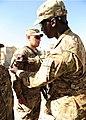 U.S. Army 1st Sgt. Amara Fofana, right, a senior adviser with the Forward Operating Base (FOB) Lightning Garrison Support Unit, 4th Battalion, 320th Field Artillery Regiment, 4th Brigade Combat Team, 101st 130606-Z-HL120-051.jpg