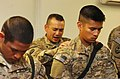 U.S. Army Capt. Ronaldo Pascua, center, a chaplain with the 1st Battalion, 294th Infantry Regiment, Guam Army National Guard, Task Force Guam, prays with deployed Soldiers Dec. 7, 2013, at Camp Phoenix 131207-Z-WM549-008.jpg