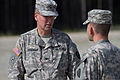 U.S. Army Col. Hunt Kerrigan, left, commander of the 38th Troop Command, speaks to Capt. Chad Ausel, a company commander with the 297th Military Police Battalion, both with the Alaska Army National Guard, during 120810-A-PV459-005.jpg