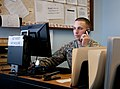 U.S. Army Spc. Anthony McGuire assigned to the 201st Battlefield Surveillance Brigade, assists a service member via phone by answering tax related questions at the Joint Base Lewis-McChord, Wash., tax center 130322-A-FS521-010.jpg