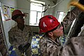 U.S. Marine Corps Pvt. 1st Class Derrick Wilkerson, left, a bulk fuel specialist with the 9th Engineer Support Battalion (ESB), 3rd Marine Logistics Group, and Lance Cpl. Braxton Moody, a bulk fuel specialist 130727-M-MG222-004.jpg