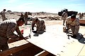 U.S. Marines with Engineer Company, Combat Logistics Regiment 2, 2nd Marine Logistics Group, build new Southwest Asia (huts at their forward operations base (FOB) during Enhanced Mojave Viper (EMV) 120910-M-KS710-014.jpg