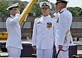 U.S. Navy Cmdr. Todd Weeks, right, renders a salute to Cmdr. Bret Grabbe in recognition of being relieved of duties as commanding officer during a change of command ceremony for the attack submarine USS 130801-N-TN558-122.jpg