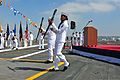 U.S. Navy Culinary Specialist Seamen Tabitha Lifa, right, and Edgar Batista perform an exhibition drill set during a change of command ceremony aboard the aircraft carrier USS Ronald Reagan (CVN 76) in San Diego 130813-N-AV746-136.jpg