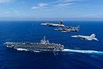 U.S. Navy and Marine Corps aircraft fly over USS Carl Vinson (CVN-70) on 20 January 2018 (180120-N-ZZ999-0002).JPG