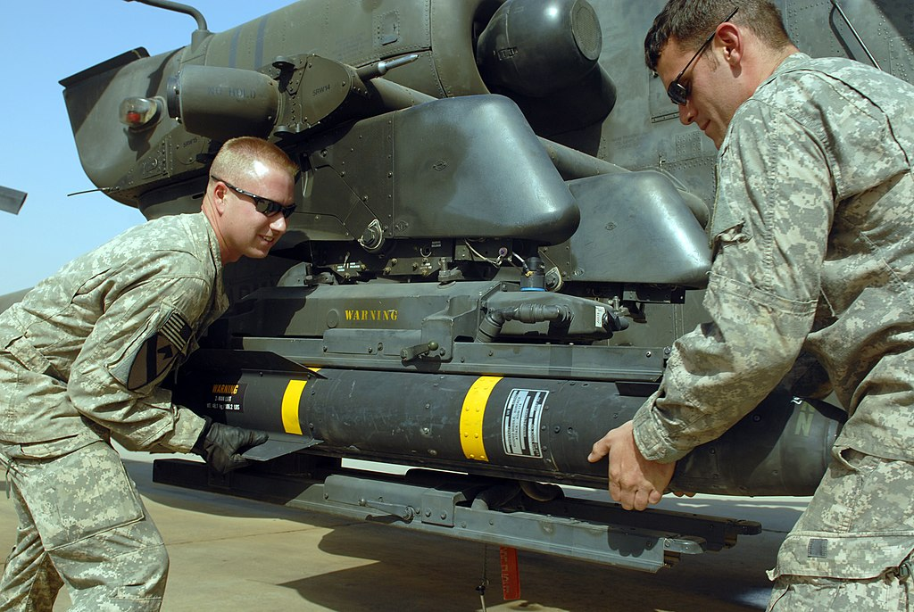 Russian Helicopter ATGMs 1024px-US_Army_52453_CAMP_TAJI,_Iraq_-_Spc._Sean_McConnell_(left),_of_Columbus,_Ohio,_and_Spc._Scott_Shaver,_of_Austin,_Texas,_load_a_Hellfire_missile_onto_the_mounting_bracket_on_an_AH-64D_Apache_helicopter,_here,_Oct._1