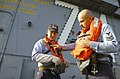 US Navy 030124-N-9769P-027 the procedures to don an inflatable life preserver during an abandon ship training scenario aboard the aircraft carrier.jpg