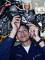 US Navy 030210-N-9228K-015 Aviation Machinist's Mate 3rd Class Anthony Aceves torques a nut on the engine of an F-A-18E Super Hornet.jpg
