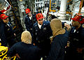 US Navy 030314-N-4048T-044 The Engineering Training Team (ETT) instructor provides feedback to watch standers in one of the main machinery spaces aboard the amphibious assault ship USS Kearsarge (LHD 3).jpg