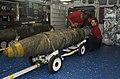 US Navy 030319-N-4142G-014 Aviation Ordnanceman Airmen Josh Dowdy, Rogelio Rosales, and Quienten Jacobsen assemble Joint Direct Attack Munition (JDAM) bombs in the forward mess decks aboard USS Constellation (CV 64).jpg