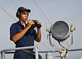 US Navy 030414-N-2160C-003 Seaman Isaac Torres from Cleveland, Ohio, vigilantly stand the ship's forward look-out watch from the signal bridge of USS Mount Whitney (LCC-JCC 20).jpg