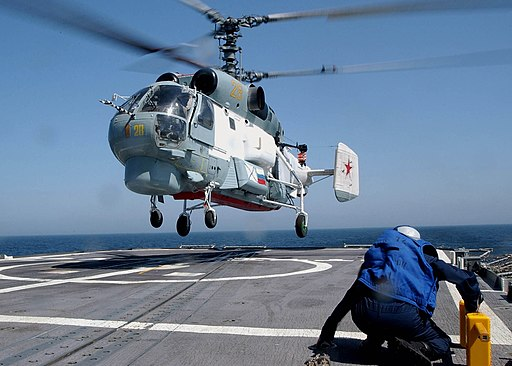 US Navy 030612-N-4374S-001 A chock and chain crew, part of the flight deck team aboard the Aegis cruiser USS Vella Gulf (CG 72) remains in a ready position while a Russian Helix K-27 helicopter lands aboard ship