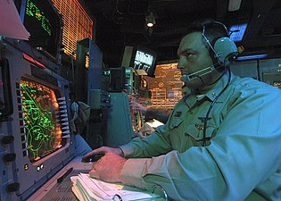 US Navy 031227-N-7408M-001 Chief Aviation Warfare Systems Operator Scott C. Montejo from Freeport, Maine, tracks air targets.jpg