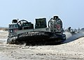 US Navy 050111-N-3557N-008 A Landing Craft Air Cushion, assigned to Assault Craft Unit Four (ACU-4), prepares to the water as it delivers Marines and equipment of the 26th Marine Expeditionary Unit (MEU) to the amphibious assau.jpg