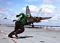 US Navy 050521-N-5884M-002 A Sailor assigned to the Air Department runs across the flight deck.jpg