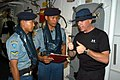 US Navy 050728-N-4104L-026 Hull Technician 1st Class William Castle, a visit, board, search and seizure (VBSS) team member aboard the guided missile frigate USS Rodney M. Davis (FFG 60) talks about his team's procedures with an.jpg