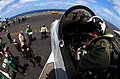 US Navy 050729-N-5549O-067 A pilot secures himself into an F-A-18E Super Hornet prior to flight operations aboard the Nimitz-class aircraft carrier USS Ronald Reagan (CVN 76).jpg