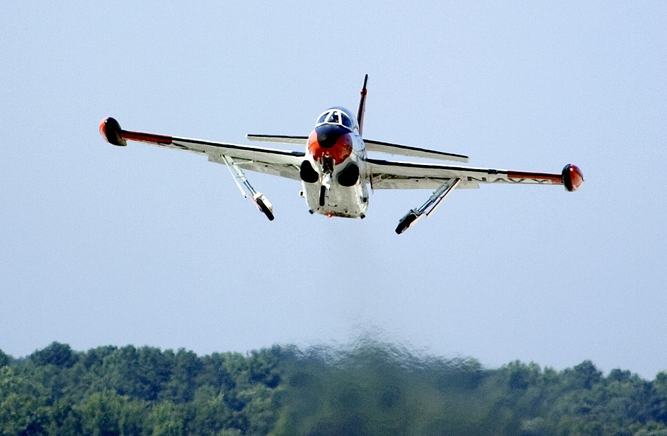 US Navy 050803-N-0295M-121 A T-2C Buckeye, assigned to the U.S. Naval Test Pilot School, folds-up its landing gear as it takes off for a training flight from Naval Air Station Patuxent River, Md