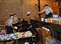 US Navy 050903-N-4374S-004 Sailors assigned to Naval Construction Training Center, Miss., transfer relief supplies for the victims of Hurricane Katrina in an equipment warehouse at the Naval Construction Battalion Center.jpg