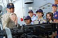 US Navy 061021-N-7498L-123 Senior Chief Cryptologic Technician (Collection) James Eaton explains to boy scouts from Troop 384 on the capabilities of the dual-mounted .50-caliber machine gun.jpg