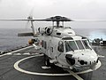US Navy 061111-N-6621K-002 A Japanese Maritime Self-Defense Force SH-60J Seahawk helicopter sits on the flight deck of guided-missile destroyer USS Curtis Wilbur (DDG 54) after flying a U.S Navy liaison officer from JDS Kirishi.jpg