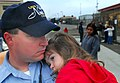 US Navy 070402-N-4776G-019 Electronics Technician 2nd Class Michael O'Brien's daughter hugs her father before he departs aboard the nuclear-powered aircraft carrier USS Nimitz (CVN 68).jpg