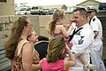 US Navy 070407-N-4856G-004 Personnel Specialist 1st Class George Nonicker assigned to the guided missile destroyer USS Russell (DDG 59) greets his family as the ship returns to Naval Station Pearl Harbor.jpg