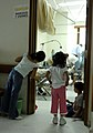 US Navy 070628-N-0194K-230 Children watch as military dentists and technicians, attached to the Military Sealift Command hospital ship USNS Comfort (T-AH 20), provide dental care to patients at the Puerto Barrios National Hospi.jpg