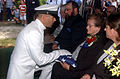 US Navy 070721-N-1755G-001 Master Chief Engineman George W. Harris, of Navy Operational Support Center Indianapolis, presents the flag to Louise Hobbs of Greenwood, Ind., and the sister of Fireman 3rd Class Alfred Eugene Living.jpg