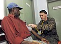US Navy 070808-N-4954I-016 Hospital Corpsman 3rd Class Michael Parke checks the blood pressure of a local Madang resident at Modilon General Hospital in support of Pacific Partnership.jpg