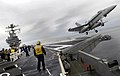 US Navy 071006-N-4166B-033 An F-A-18 Hornet attached to the Warhawks of Strike Fighter Squadron (VFA) 97 conducts a touch and go landing and takeoff aboard the Nimitz-class aircraft carrier USS Abraham Lincoln (CVN 72).jpg