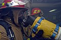 US Navy 080217-N-5253W-001 Sailors aboard the Arleigh Burke-class guided-missile destroyer USS Fitzgerald (DDG 62) enter a smoke-filled compartment to battle a simulated shipboard fire during an integrated training team (ITT) d.jpg