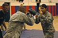 US Navy 080612-A-1912B-128 Army Spc. Evelin Andrade participates in a drill of achieving a clinch during the modern army combatives class at Denich Gym June 9-13.jpg