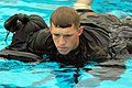 US Navy 080722-N-2959L-127 Seaman Apprentice Damien Bell uses his uniform as a floatation device.jpg