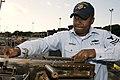 US Navy 090226-N-6674H-003 Mate 1st Class Max Gassant works on a .50 caliber machine gun.jpg