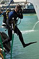US Navy 090323-N-9301D-133 Chief Navy Diver Jason Potts, assigned to Mobile Diving and Salvage Unit Two (MDSU 2), jumps into the water to perform an underwater inspection on the amphibious transport dock ship USS New Orleans (L.jpg