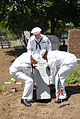 US Navy 090522-N-4936C-073 Sailors assigned to the guided-missile cruiser USS Vella Gulf (CG 72) place a new headstone for a World War I veteran at Lake Cemetery in Staten Island.jpg