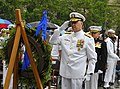 US Navy 090604-N-8273J-146 Chief of Naval Operations (CNO) Adm. Gary Roughead salutes a wreath honoring those who fought in the Battle of Midway during the Battle of Midway Commemoration Ceremony.jpg