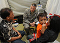 US Navy 091010-F-3177P-029 Maj. Scott Hughes gathers medical information from a patient with the help of Hasbi, a local interpreter.jpg
