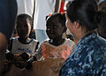 US Navy 100202-N-4971L-169 Sailors give relief supplies to Haitian children.jpg