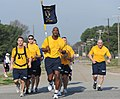 US Navy 100324-N-5862D-003 Chief Petty Officer Greg Fall, right, leads fellow chief petty officers in cadence.jpg