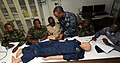 US Navy 100416-N-6676S-002 Hospital Corpsman 1st Class Jason Ashmeade, center, from Long Island, N.Y., demonstrates to service members from the Senegal, Liberia, Sierra Leone, Gambia and Equatorial Guinea armed forces the prope.jpg