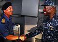 US Navy 100506-N-0995C-547 Capt. Richard L. Clemmons greets Lt. Col. Othman.jpg