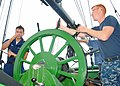US Navy 100714-N-5647H-170 Fireman Apprentice Esteban Quintero, left, and Airman Dylan Roberts, both assigned to USS Constitution, steer the rudder aboard the Friendship of Salem.jpg